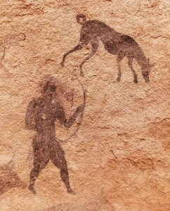 Bir mağarada bulunan avcı ve köpeği resmi